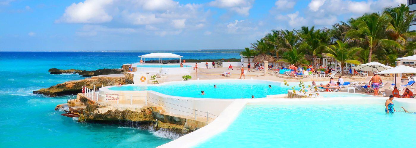 swimming pools at beach resort.