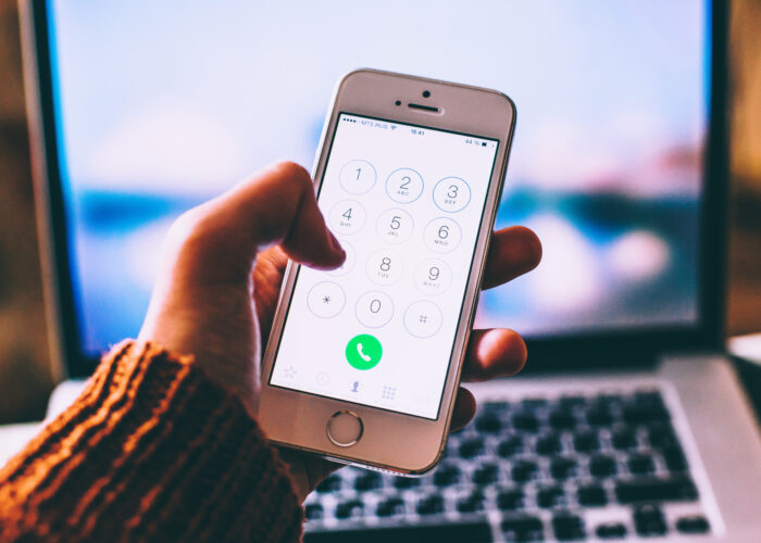 saving one of the emergency numbers around the world into iPhone.