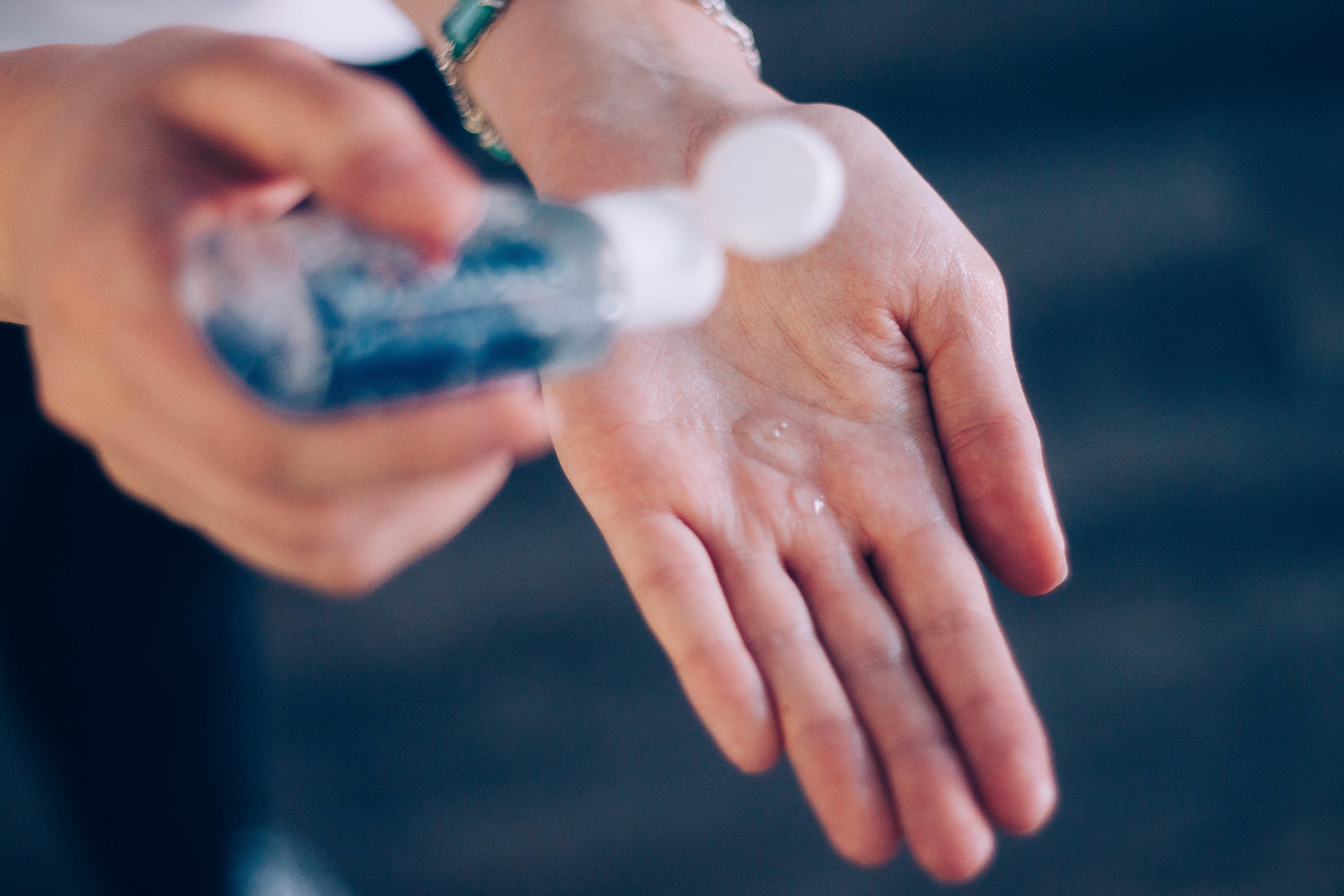 person applying hand sanitizer.