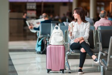 Airport Woman with Coffee in Hand Don't Buy at Airport