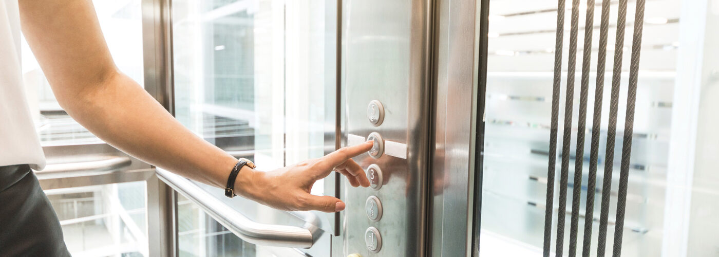 woman pressing elevator button. finger presses elevator button. businessman in lift - Image