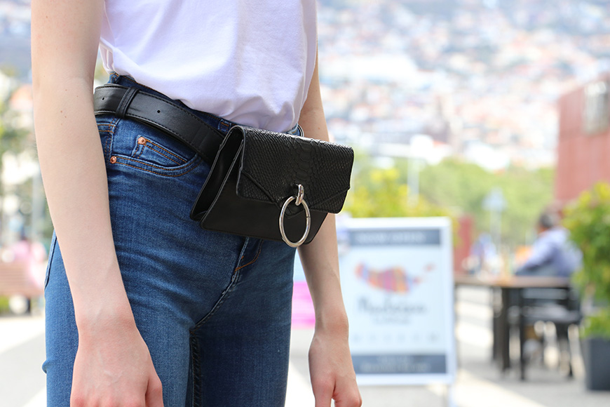 Girl with black leather waist bag.