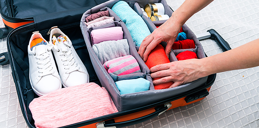 clothes rolled into a suitcase