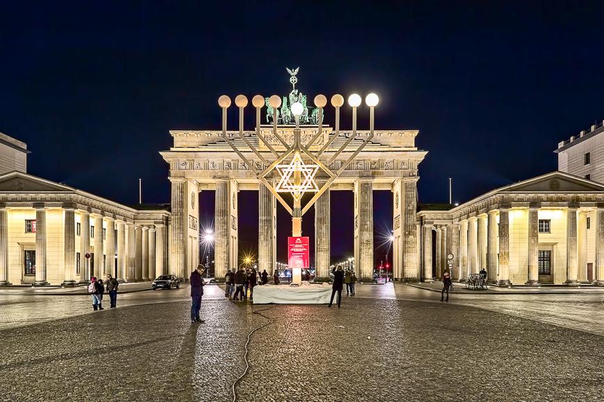 Hanukkah menorah at pariser platz (paris' square) in front of brandenburg gate night