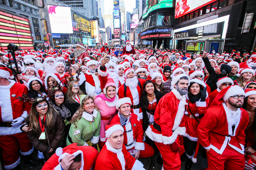hundreds of costumed revelers filled times square to muster for the 17th annual santacon pub crawl