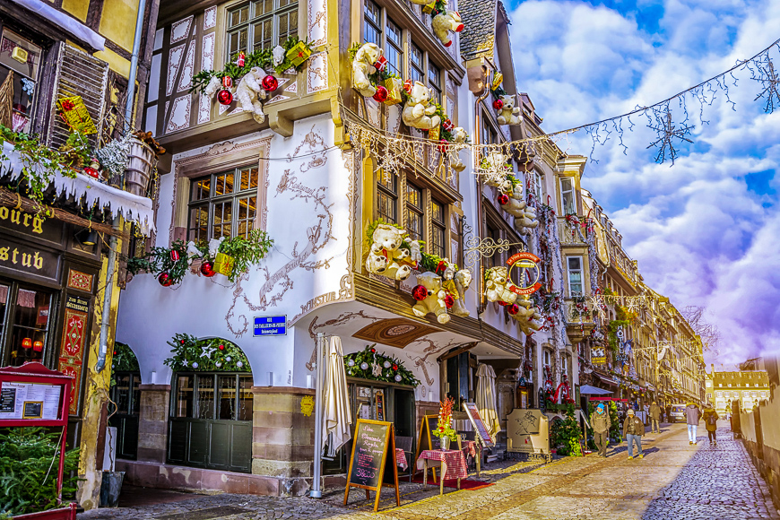 Streets and facades of houses, traditionally decorated with toys teddy bears for christmas