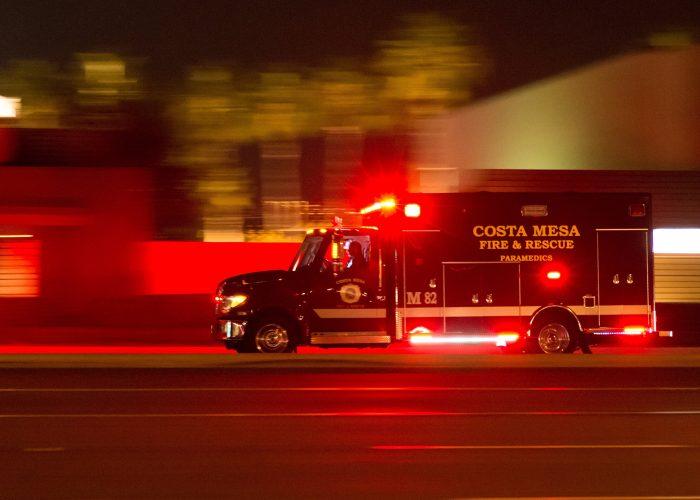 ambulance at night with lights flashing.