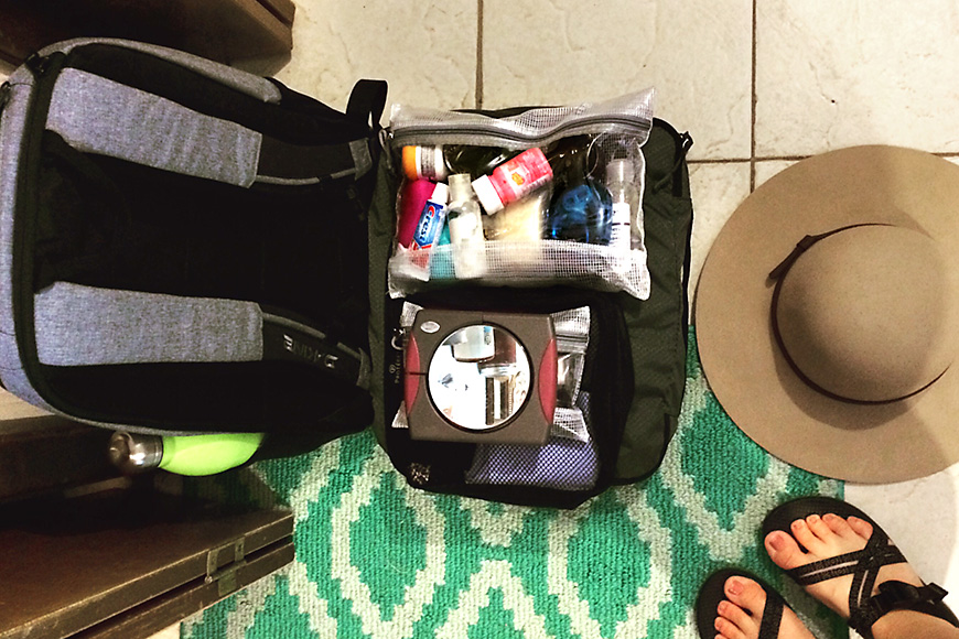 open suitcase showing a toiletry bag