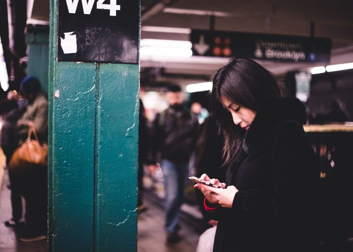 woman on subway platform in new york