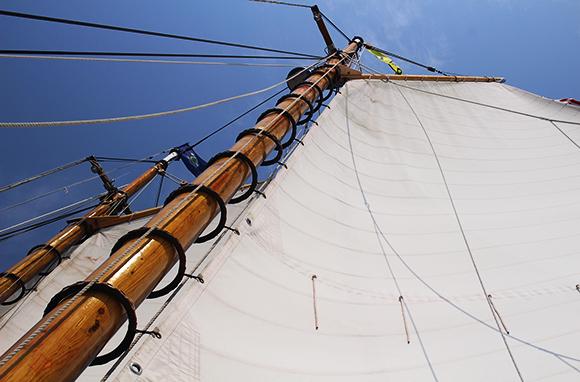 Hoisting the Sails on Schooner Olad