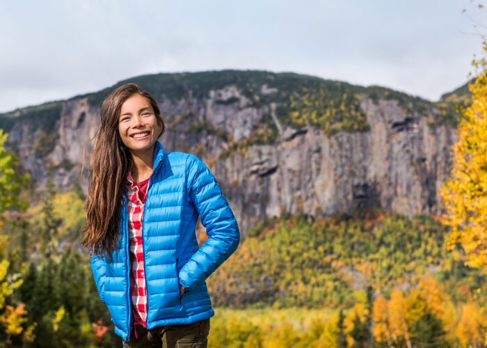 girl wearing blue down jacket enjoying fall season
