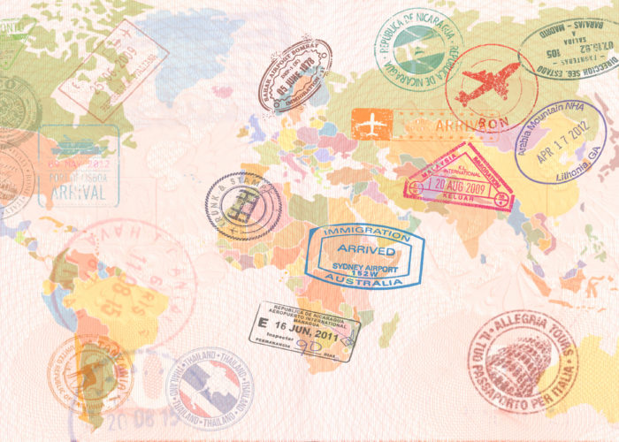 World map covered in passport stamps