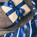 Gift, neck tie, and coffee on table