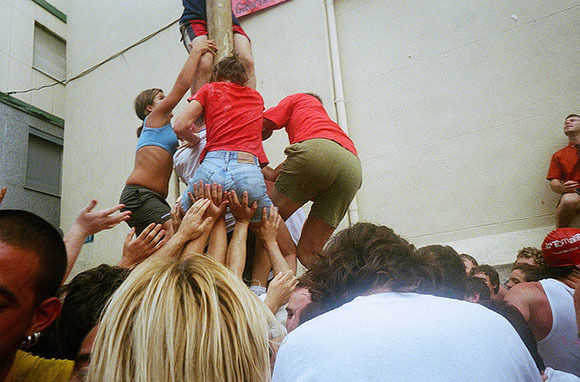 The Entire Event Depends on a Ham Atop a Greased Pole