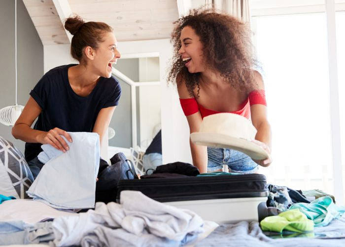 Two Women Packing Suitcase