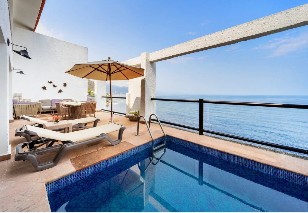 ocean hotel room view in mexico with pool