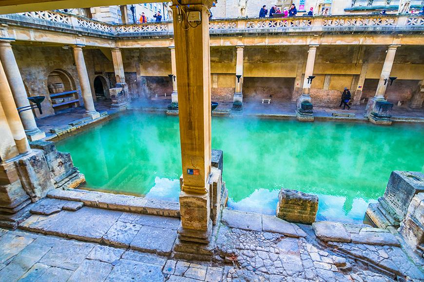 Bath, England - December 10 2017: Steaming Roman Baths in winter
