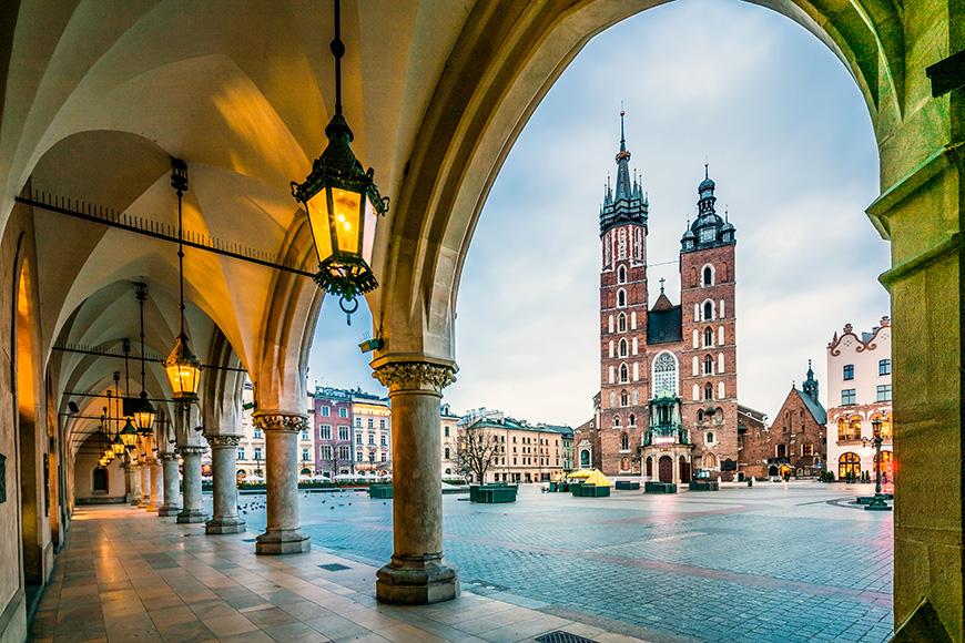Beautiful Krakow market square, Poland, Europe. Faded colors.