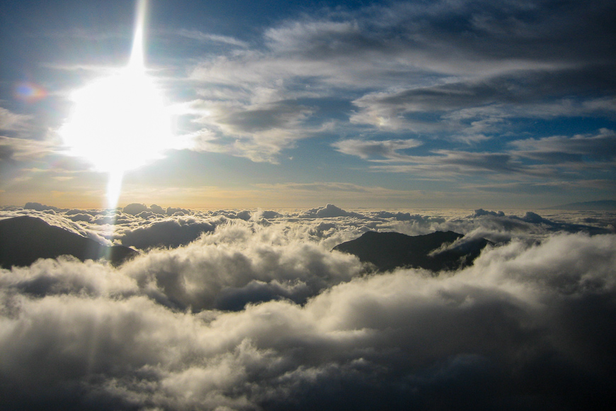 Sea of clouds with the bright sun on haleakala national park