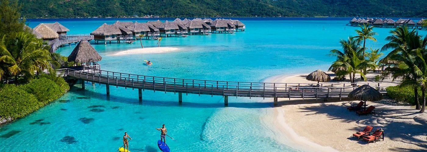 two people paddleboarding InterContinental Bora Bora Resort & Thalasso Spa