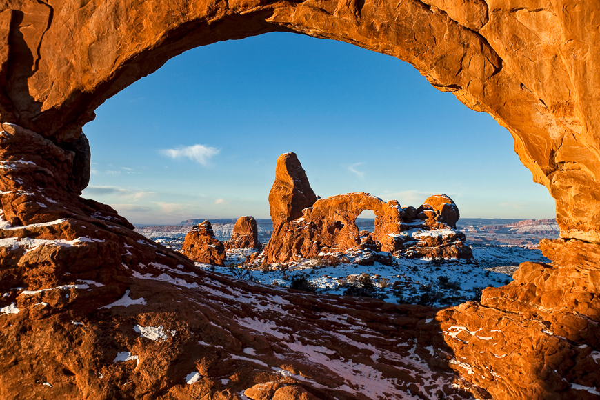 First light on turret arch framed by north window