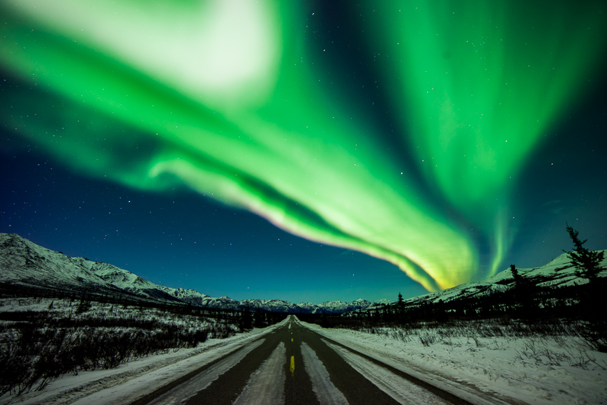 A long exposure lets the camera capture movement of ribbons aurora in denali