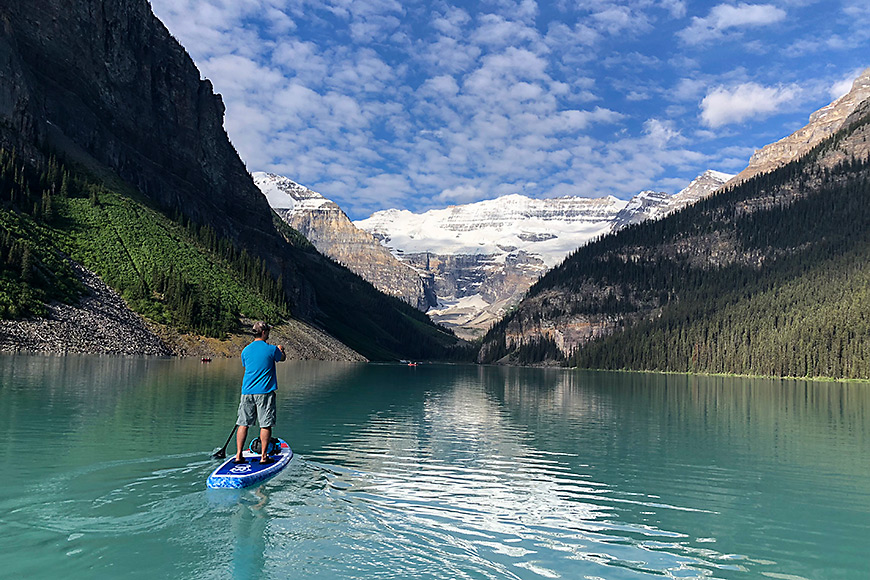 man paddles on lake louise in canada