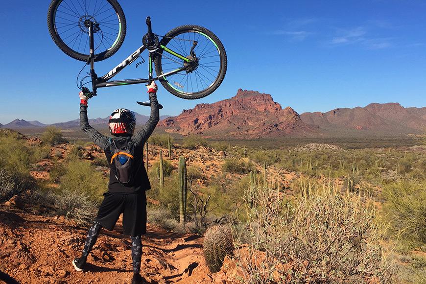Man holds a bike in the air phoenix arizona