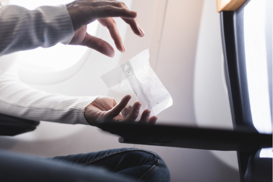 eating peanuts on plane.