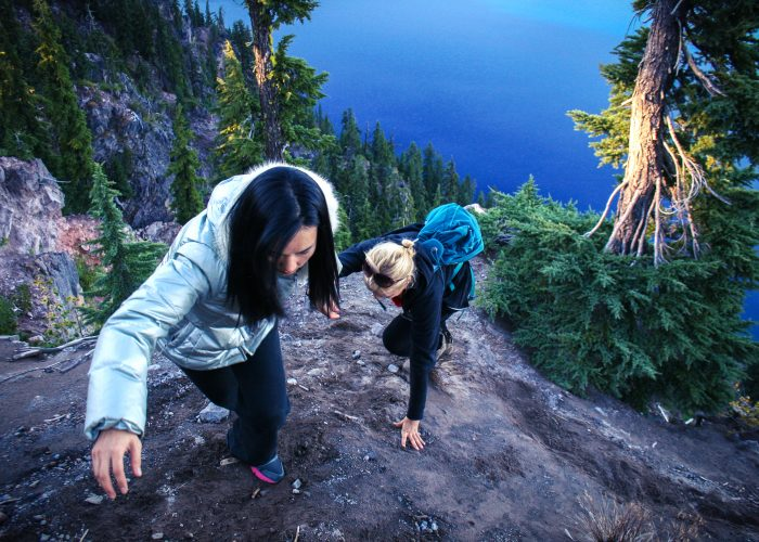two girls climbing mountain