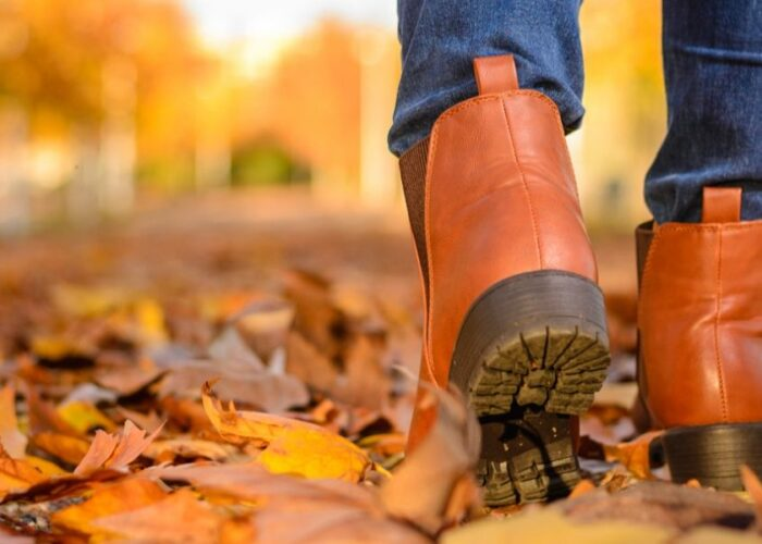 brown boots walking in fall leaves.