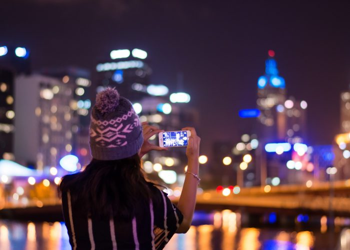 Woman taking iPhone photo