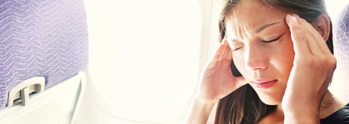 Women on plane feeling sick
