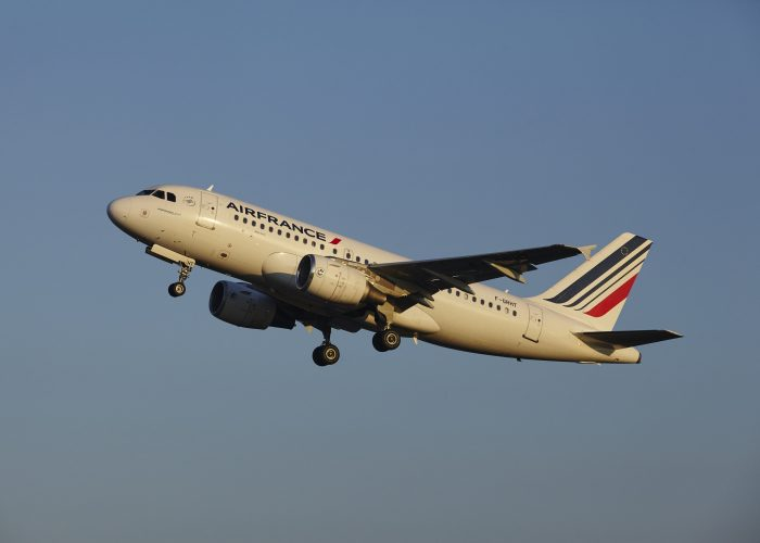 Air France - Airplane in Blue Sky Airfare Sale