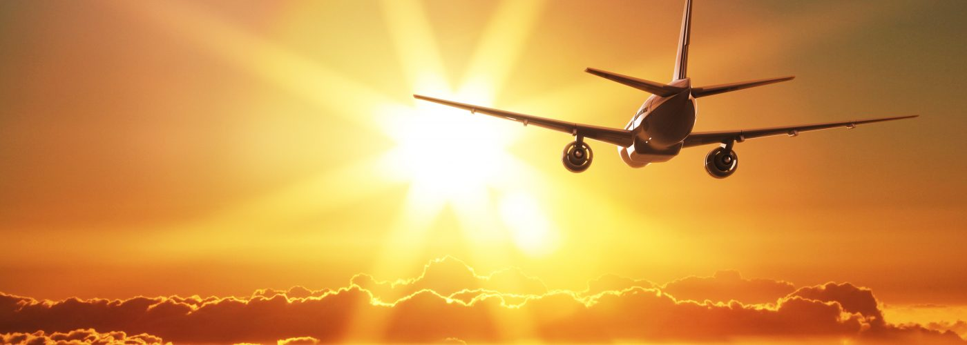 Transatlantic Flights Airplane Nondescript Flying Off Toward Sunset
