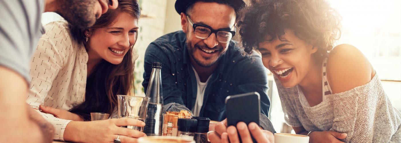 People - Friends Gather Around a Phone Google Translate