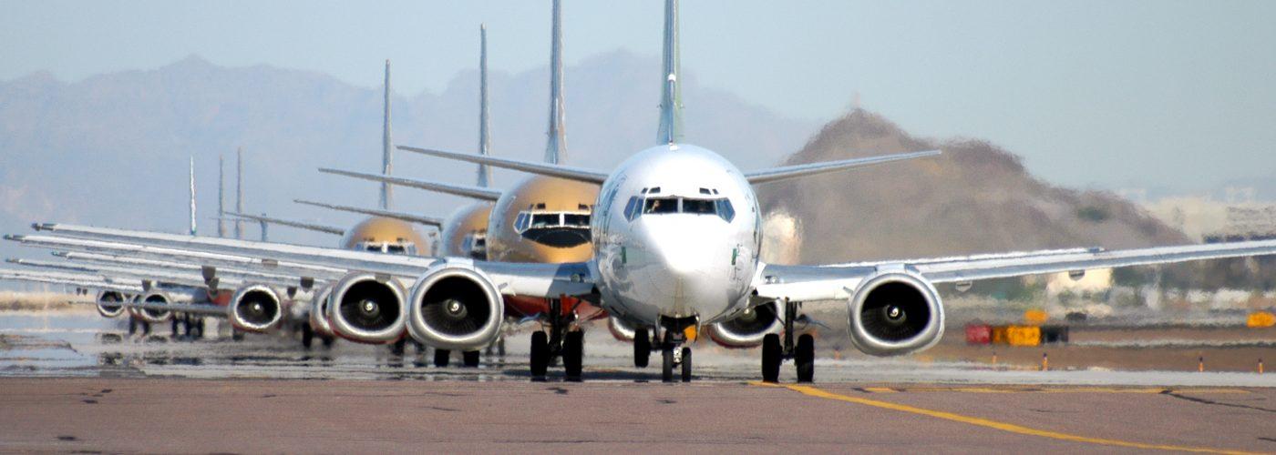 Airplane - Nondescript Row of Planes Airfare Sales