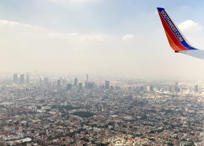 Southwest - Airplane Wing Over City Scape