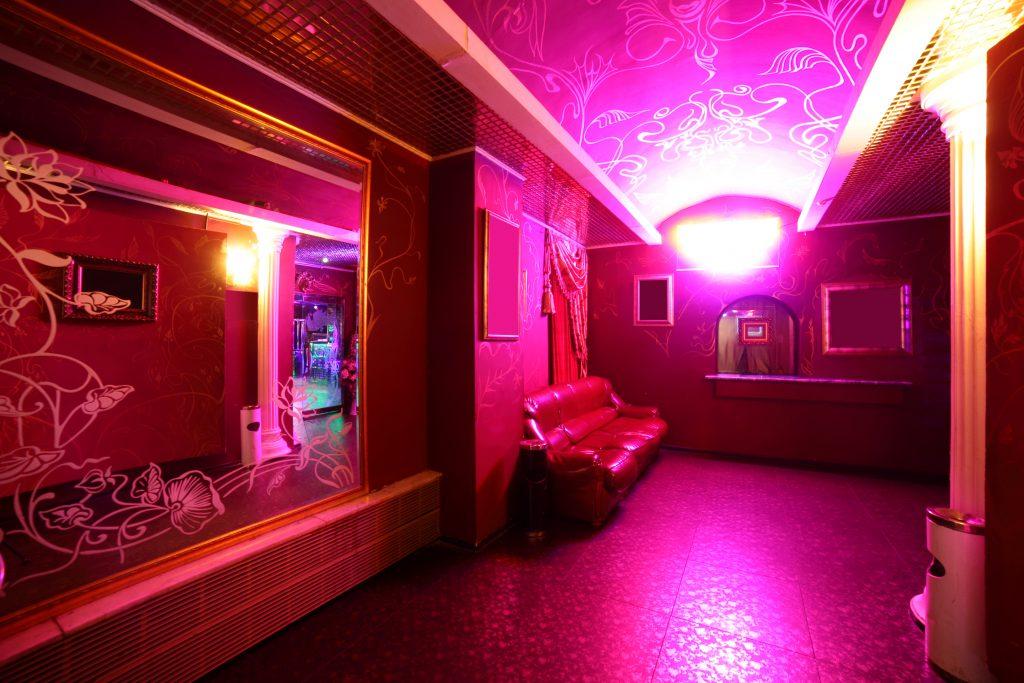 Pink illuminated nightclub hallway