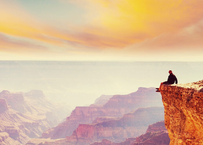 hiker watching sunset in Grand Canyon Nation Park