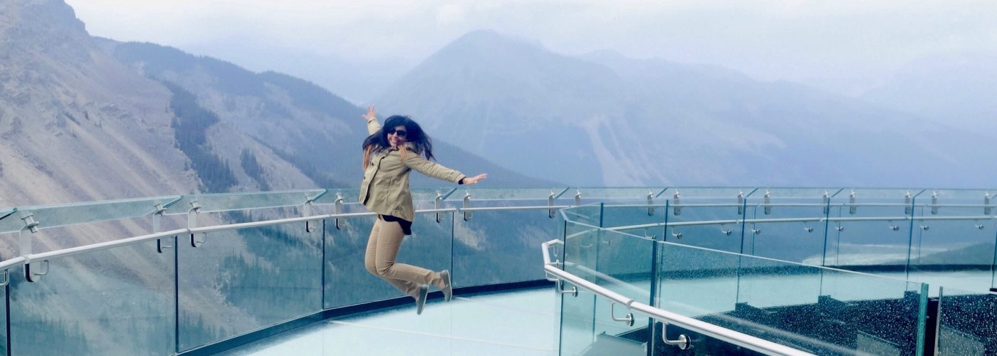 Woman jumping on the Jasper Skywalk