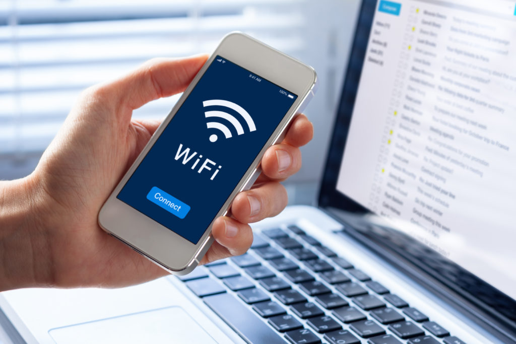 Person connecting their cellphone to WiFi