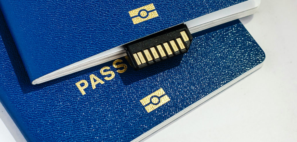 Two passports with an international SIM card