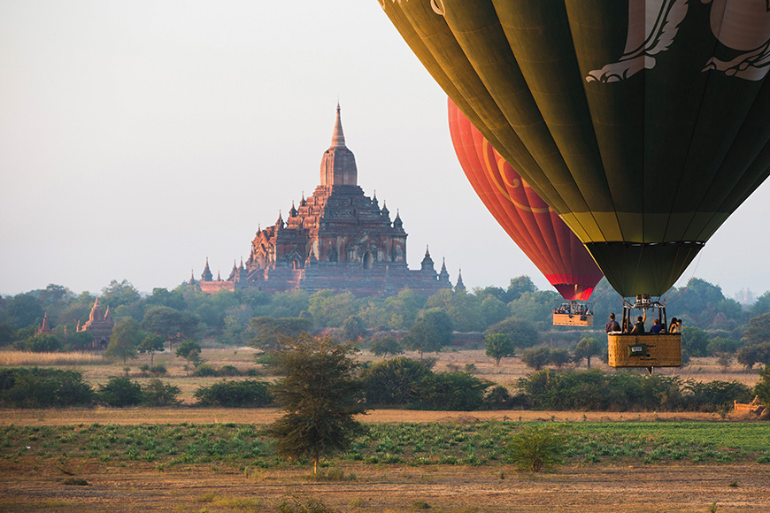 Hot air balloons fly over Bagan, that always recognised as amazing buddhism landmark.