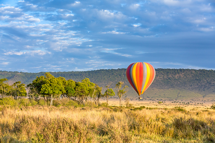 Low flying hot-air balloon in the Masai Mara, Kenya