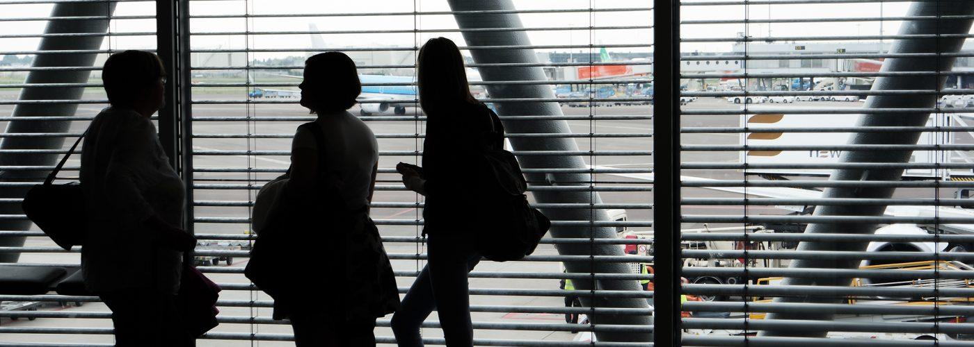 travelers at airport gate