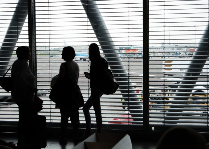 travelers at airport gate
