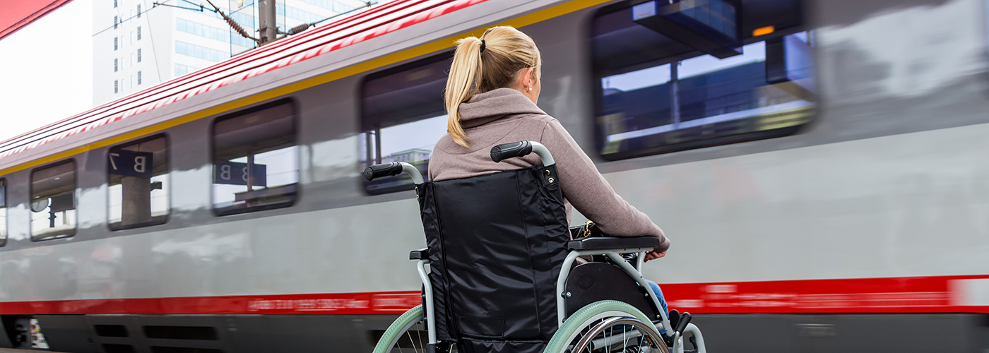 woman in wheelchair with train
