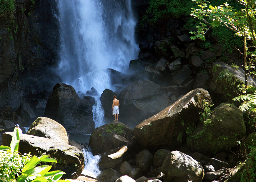 dominica waterfall and hiker