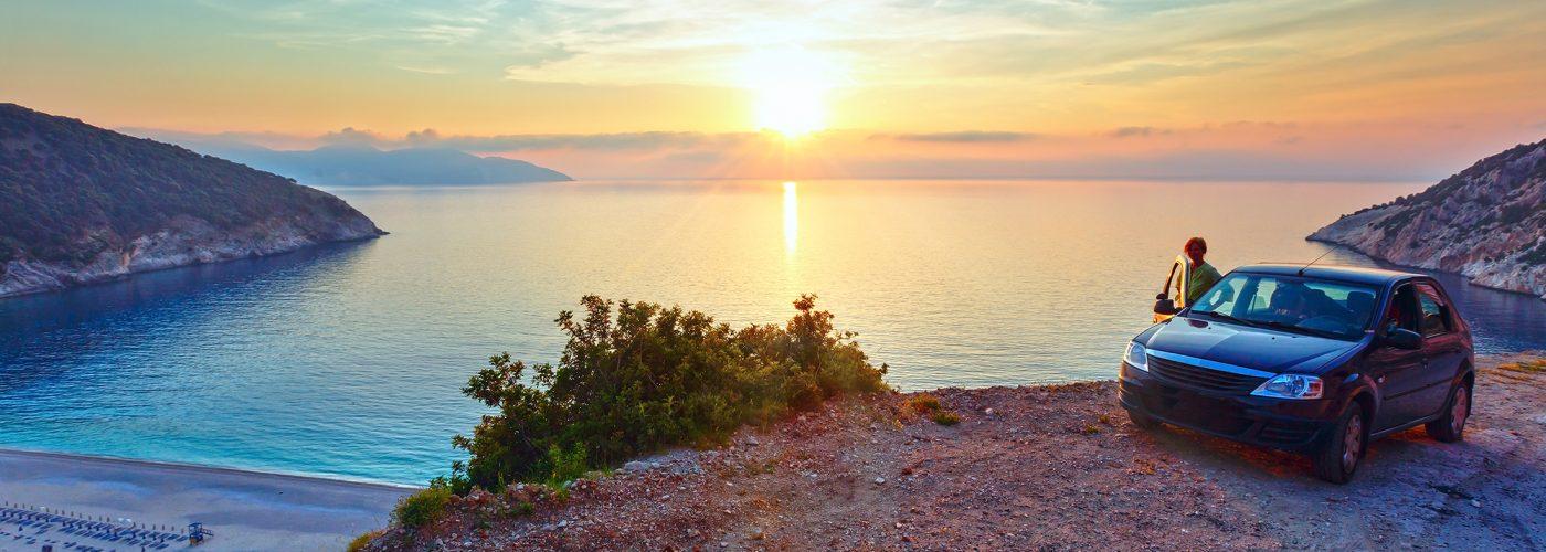 car overlooking greek sunset